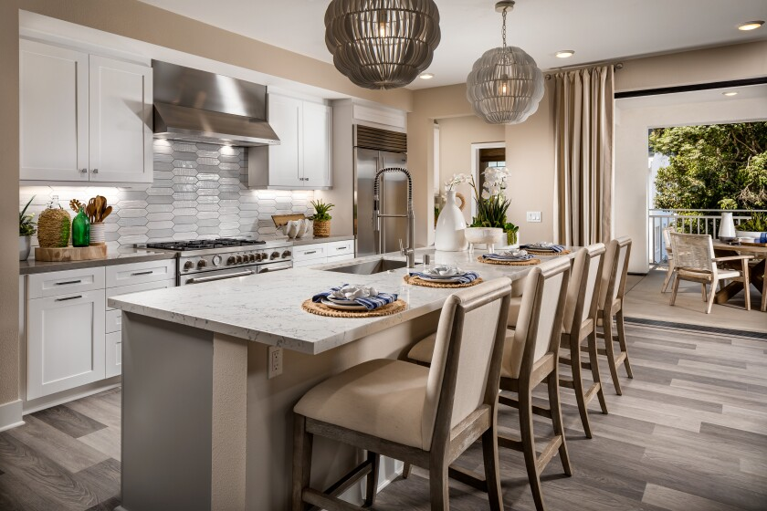 Homes at Carlyle in Carlsbad feature open concept floor plans that connect to outdoor spaces through pocket-door systems.