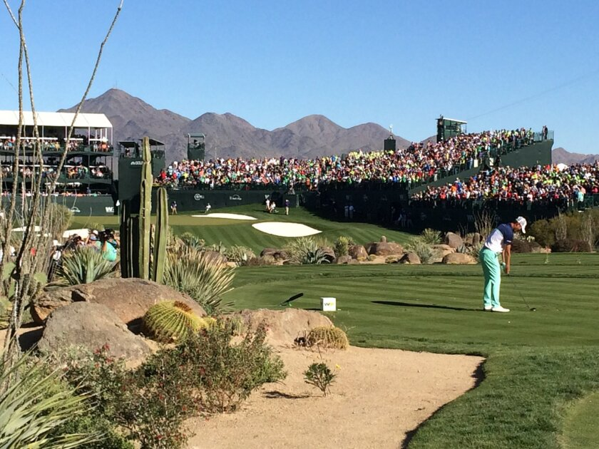 In this Saturday, Feb. 5, 2016, photo, Danny Lee prepares to tee off on the 16th hole during the third round of the Phoenix Open golf tournament at TPC Scottsdale in Scottsdale, Ariz. A picturesque par-3 for 51 weeks, No. 16 at TPC Scottsdale transforms into a golf version of a party cruise the wee