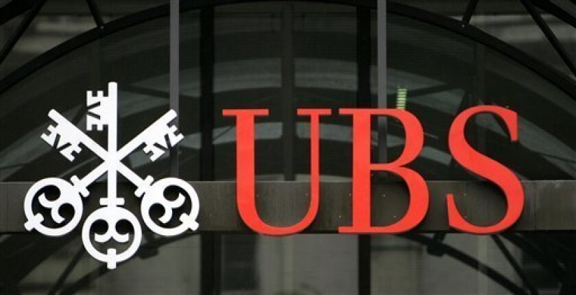 FILE- In this file photo dated Monday Oct. 1, 2007, showing a logo of global financial services company UBS in central London. Switzerland's government efforts to calm a banking crisis while keeping its treasured banking secrecy rules, hit a major setback Tuesday June 8, 2010, as nationalist and left-wing lawmakers blocked a treaty with the United States that would have allowed Swiss bank UBS to hand over some thousands of files on its American clients, as demanded by U.S. tax authorities.(AP Photo/Akira Suemori)