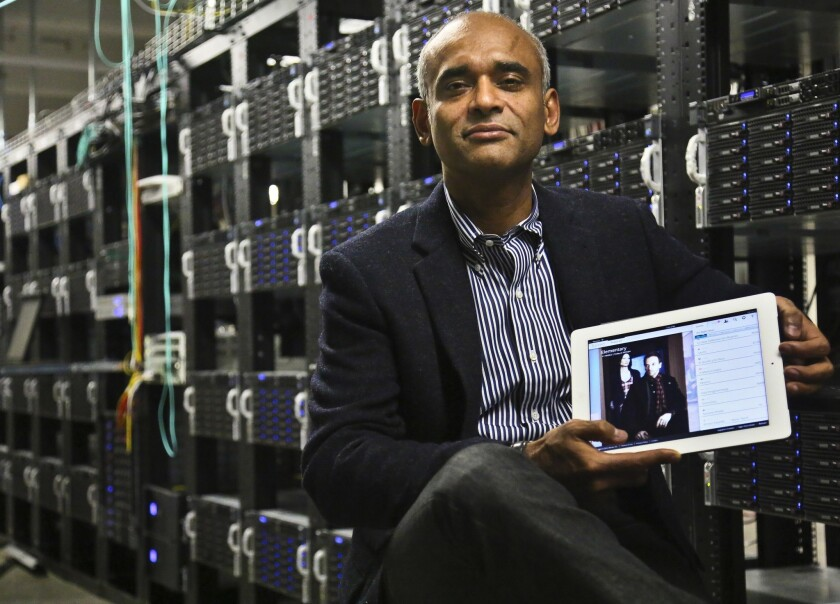 In this December 2012 file photo, Chet Kanojia, founder and CEO of Aereo Inc., shows a tablet displaying his company's technology in New York. Aereo is one of several start-ups created to deliver traditional media over the Internet without licensing agreements.