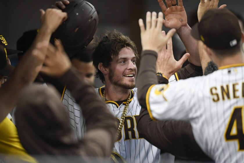 The Padres' Wil Myers is congratulated in the dugout after hitting a solo home run