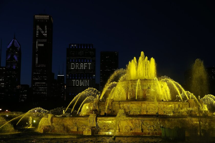 Buckingham Fountain in Chicago's Grant Park is illuminated yellow as the New Orleans Saints announce their draft picks in the 2015 NFL Football Draft Thursday, April 30, 2015, in Chicago. (AP Photo/Andrew A. Nelles)