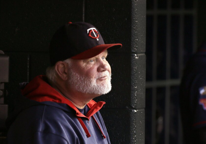 FILE - In this Saturday, Sept. 27, 2014, file photo, Minnesota Twins manager Ron Gardenhire sits in the dugout during the first inning of a baseball game against the Detroit Tigers in Detroit. The Twins fired Gardenhire on Monday, Sept. 29, 2014, after 13 seasons that included at least 92 losses in each of the last four years. (AP Photo/Carlos Osorio, File)