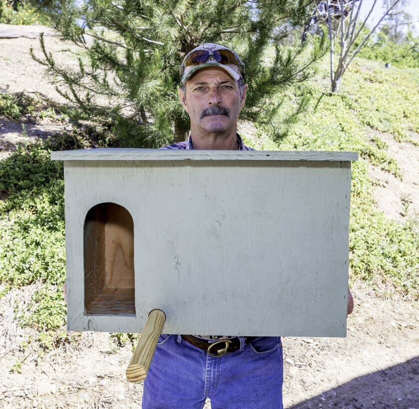 Air Superiority's Tom Stephan, with a basic owl box. To find out more about barn owl boxes or to purchase one for your yard, call Air Superiority at (760) 445-2023 or visit barnowlboxes.com