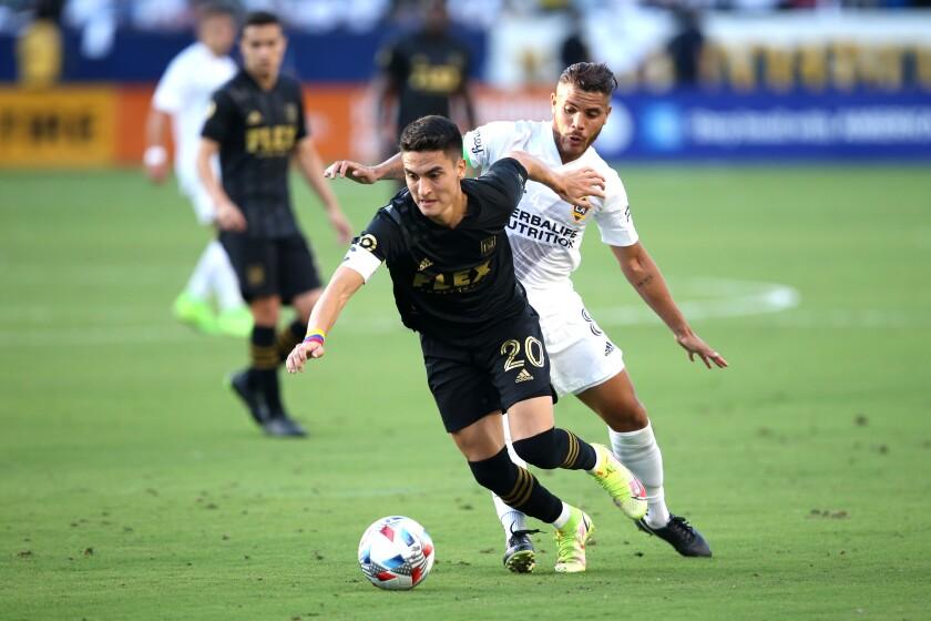 LAFC midfielder Eduard Atuesta controls the ball in front of Galaxy midfielder Jonathan dos Santos.