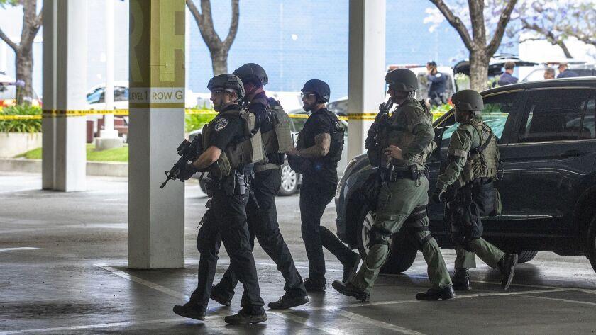 TORRANCE, CA-JUNE 3, 2019: Members of the El Segundo walk thru a parking structure while preparing