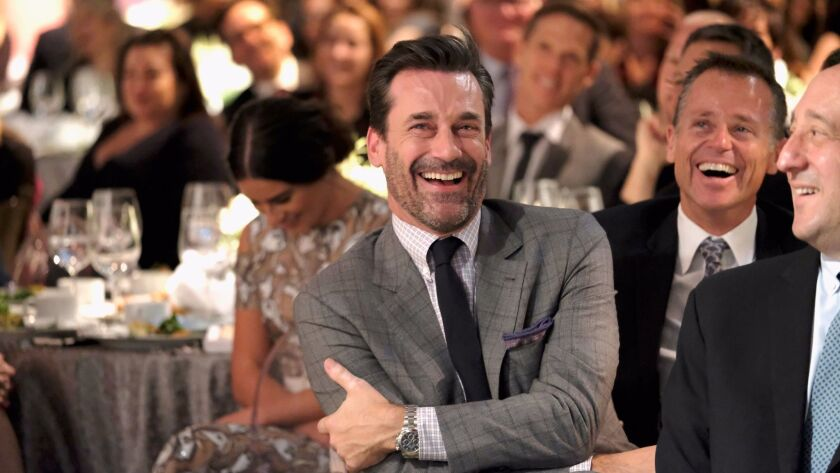 Jon Hamm shares a laugh with the crowd at the Hollywood Reporter's annual Hollywood breakfast of industry power players.