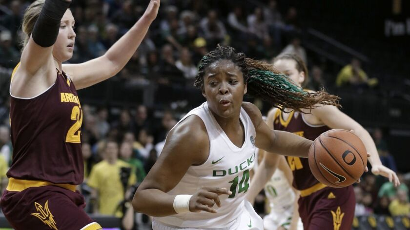 Oregon's Jillian Alleyne, right, drives past Arizona State's Kelsey Moos during the second half of a