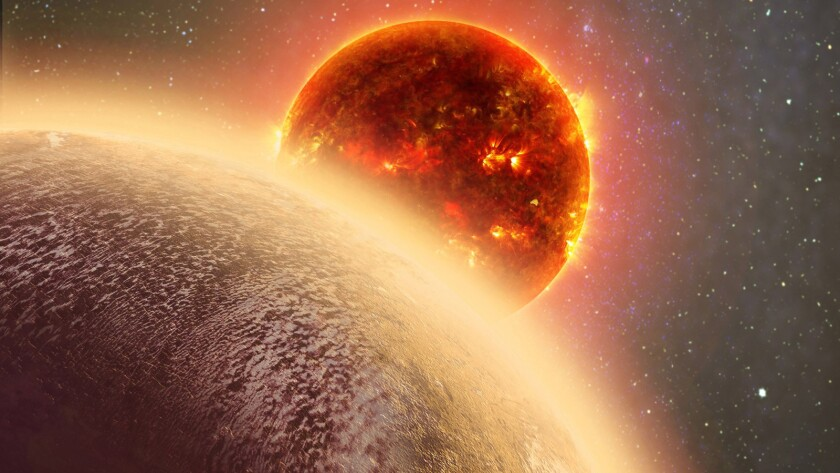 This artist's conception made by Dana Berry of SkyWorks and provided by NASA on Nov. 6 shows GJ 1132b, front, a rocky planet similar to the Earth in size and mass, orbiting a red dwarf star.
