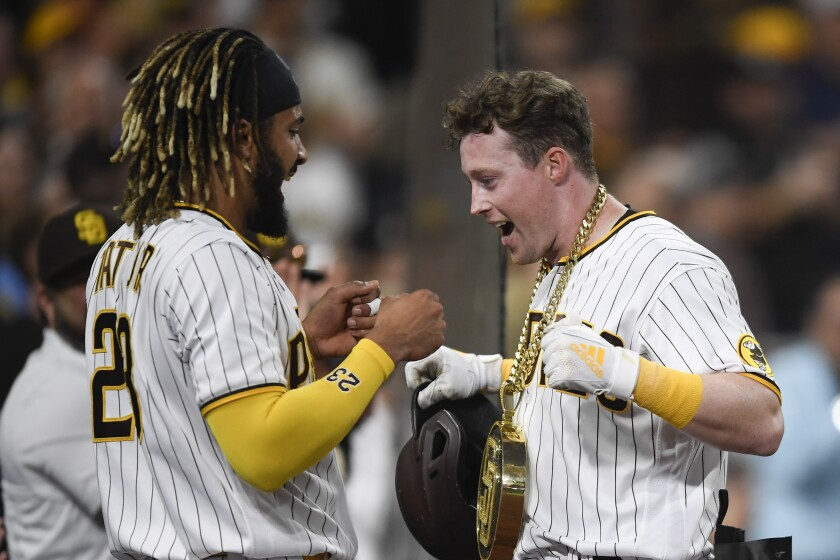 "The Padres' Fernando Tatis Jr. puts the ""Swagg Chain"" on Jake Cronenworth"