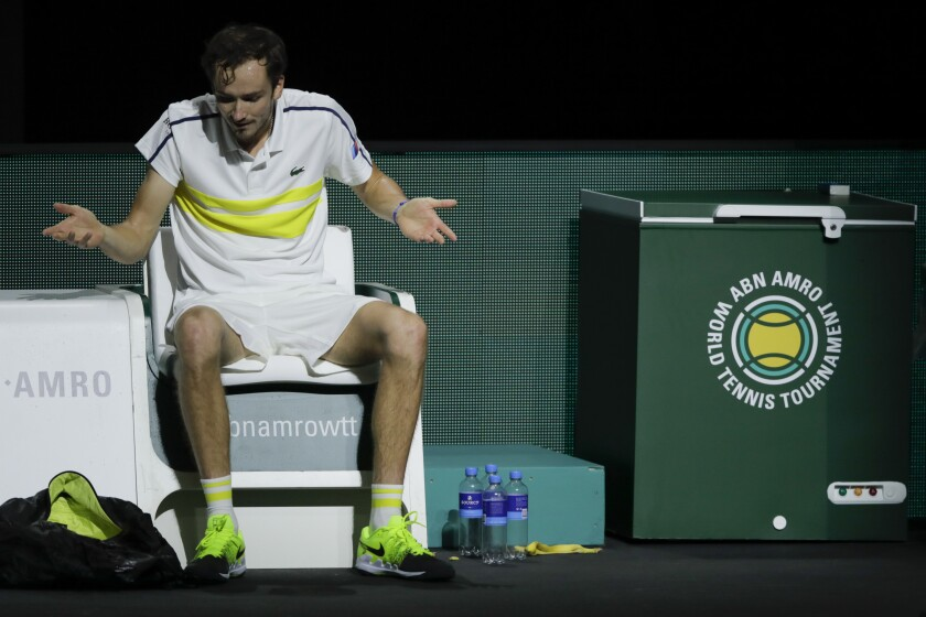 Russia's Daniil Medvedev throws his arms in the air after losing against Serbia's Dusan Lajovic in their first round men's singles match of the ABN AMRO world tennis tournament at Ahoy Arena in Rotterdam, Netherlands, Wednesday, March 3, 2021. (AP Photo/Peter Dejong)