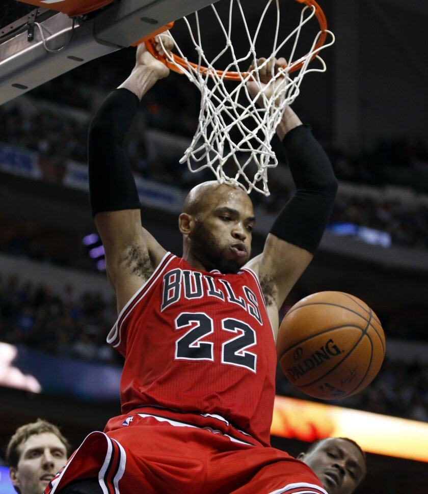 Chicago Bulls forward/center Taj Gibson (22) slam dunks the ball during the second half of an NBA basketball game against the Dallas Mavericks, Friday, Feb. 28, 2014, in Dallas. Chicago won 100-91. (AP Photo/John F. Rhodes)