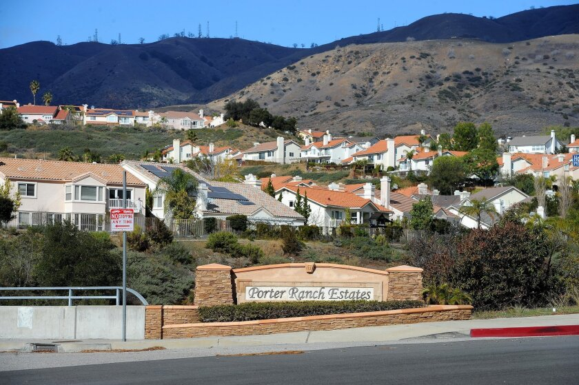 FILE- In this Jan. 7, 2016 file photo, Porter Ranch Estates sit at the foothills near a Southern California Gas Co. gas well that spewed natural gas for nearly four months before getting plugged Feb. 18, 2016. (AP Photo/Michael Owen Baker, File)