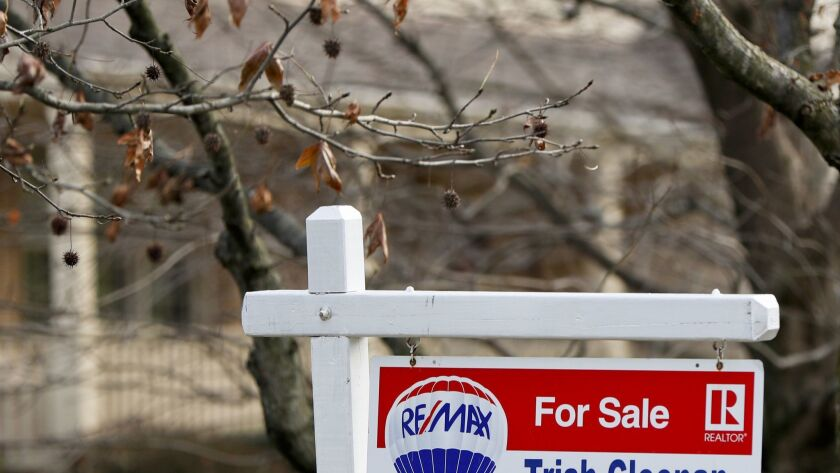 FILE - In this Jan. 3, 2019, file photo a realtor sign marks a home for sale in Franklin Park, Pa.