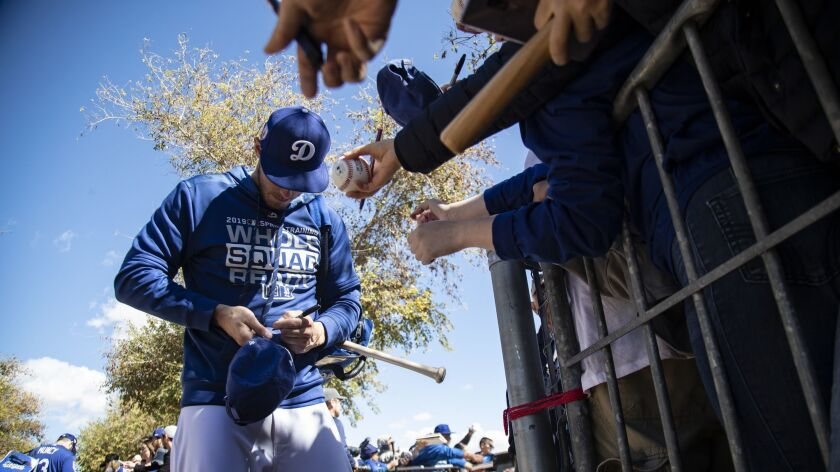 GLENDALE, AZ - FEBRUARY 19, 2019: Dodgers outfielder Cody Bellinger signs autographs during spring