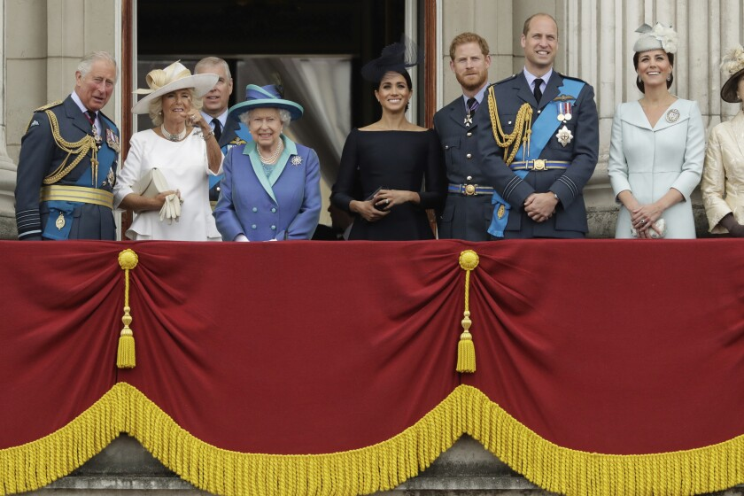 FILE - In this Tuesday, July 10, 2018 file photo, members of THE royal family gather on the balcony of Buckingham Palace, with from left, Britain's Prince Charles, Camilla the Duchess of Cornwall, Prince Andrew, Queen Elizabeth II, Meghan the Duchess of Sussex, Prince Harry, Prince William and Kate the Duchess of Cambridge, as they watch a flypast of Royal Air Force aircraft pass over Buckingham Palace in London. The timing couldn't be worse for Harry and Meghan. The Duke and Duchess of Sussex will finally get the chance to tell the story behind their departure from royal duties directly to the public on Sunday, March 7, 2021 when their two-hour interview with Oprah Winfrey is broadcast. (AP Photo/Matt Dunham, File)