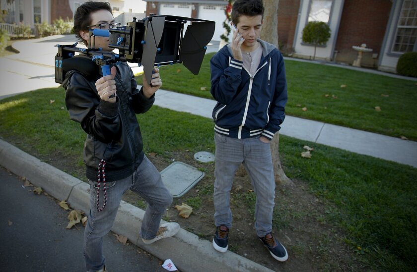 """Filmmaking brothers, Colin McGuire, left, and Connor McGuire, right, get ready to shoot a scene on a residential street in Temecula for the fan film they are making to coincide with the upcoming movie, """"Parker."""""""