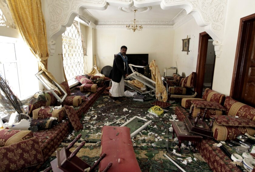 A Yemeni checks the damage at a house after a raid by Saudi-led coalition warplanes on a missile depot in the rebel-held part of Sana, the capital, on April 20.