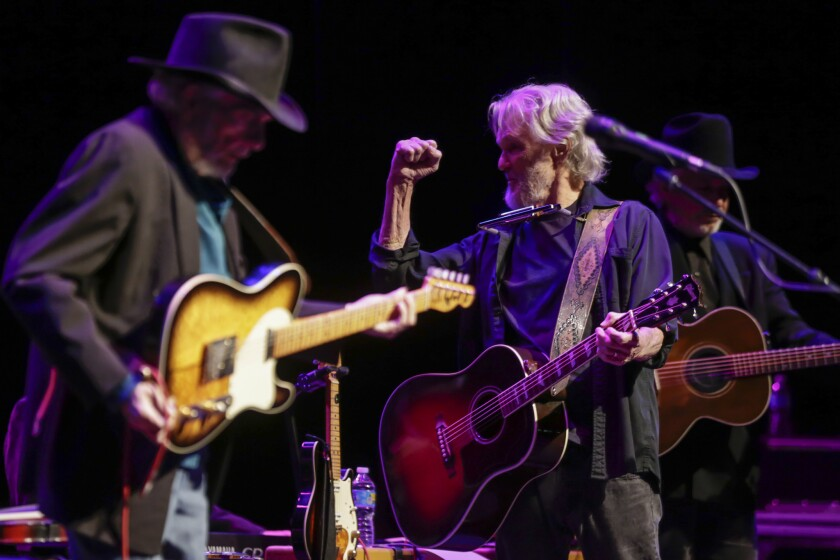 Merle Haggard, left, is joined by Kris Kristofferson during a collaborative tour stop on Thursday, Feb. 11, at the Saban Theater in Beverly Hills.