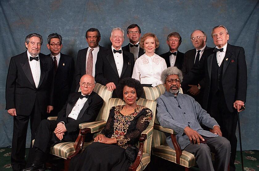 Rita Dove, seated, in 1995 with Nobel Laureates (from left) Octavio Paz, Kenzaburo Oe, Claude Simon, Derek Walcott, Wole Soyinka, Joseph Brodsky, Czeslaw Milosz, plus former President Jimmy Carter and Rosalyn Carter, with others