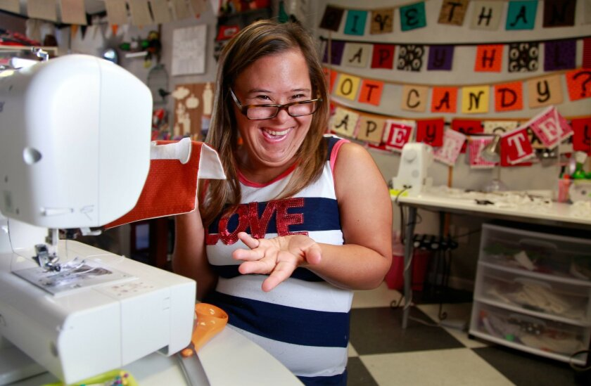 Jasmine Prince, 19, works at a shop in Encinitas that provides opportunities for others with special needs. Misael Virgen • U-T