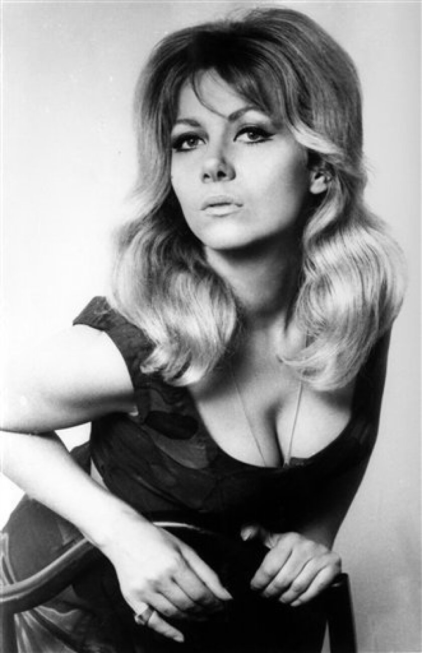 """File - Polish-born actress Ingrid Pitt is seen in this Dec. 19, 1968 b/w file photo. Ingrid Pitt, who survived a Nazi concentration camp to become an acclaimed British movie actress, has died. Dubbed """"the first lady of English horror"""" by her fans, Pitt also dodged Communist police in Germany before moving to England to become one of the country's best-known fright film stars. She played in movies such as """"Where Eagles Dare"""" and """"The Wicker Man"""" along with a slew of camp horror classics. She was 73 years old. (AP Photo/ File) EDITORIAL USE ONLY"""