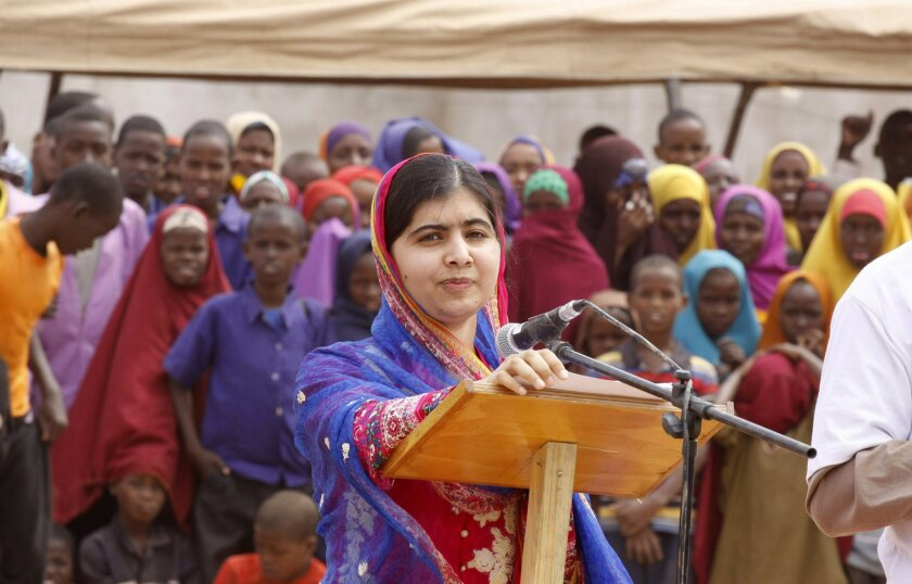 Malala Yousafza, speaks to refugees in the Dadaab refugee camp, Kenya, Tuesday, July 12, 2016. Nobel laureate Malala Yousafzai is spending her 19th birthday in Kenya Tuesday visiting the world's largest refugee camp to draw attention to the global refugee crisis, especially as Dadaab camp faces pre