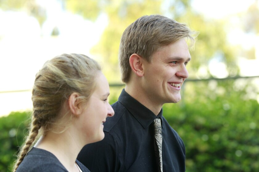 """Grayson Cornwell and his sister Sheldon smile as they recall their sister Madison, a UCSD medical student who was killed last week by a drunk driver. """"Her smile could make you laugh even in the worst of days"""" he said."""