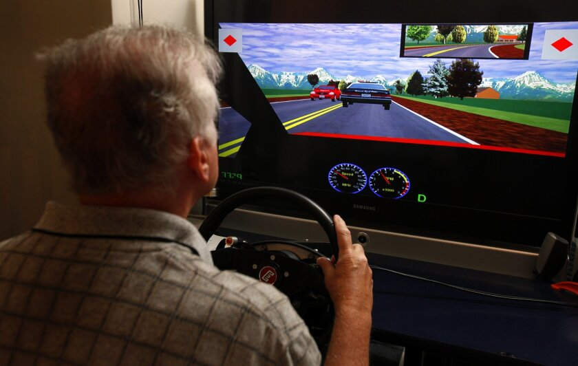 Tom Burke, who suffered a stroke four years ago, uses a driving simulator at the Driving Performance Lab at Sharp Memorial Hospital's rehab center.