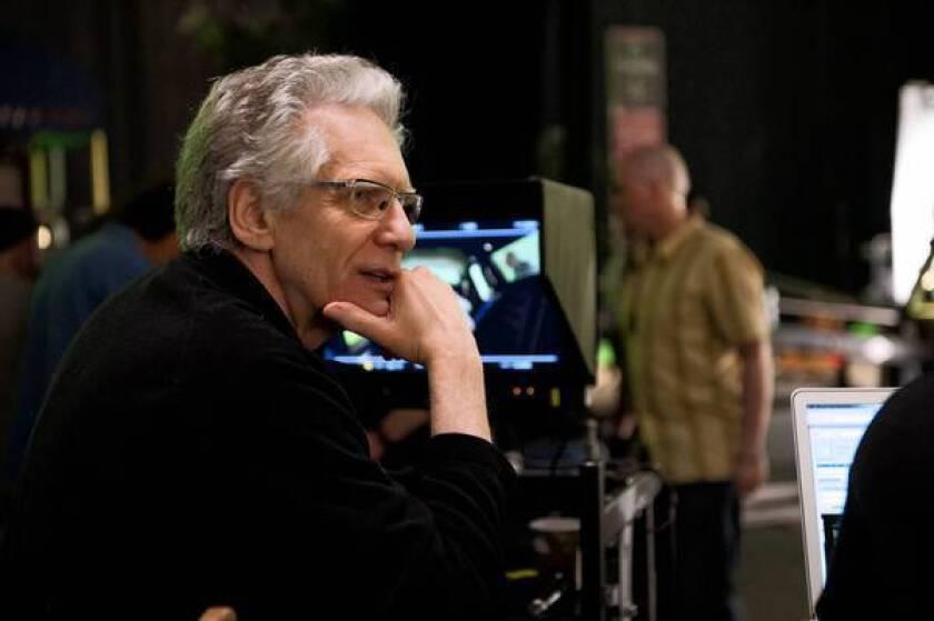 "David Cronenberg directing the movie ""Cosmopolis."""