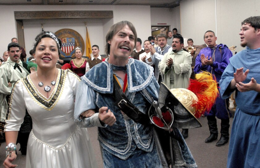 FILE - In this Sept. 5, 2006, file photo, Jessica Lucero, left, dressed as the Fiesta Queen, and Jaime Dean, right, dressed as 17th Century Spanish conquistador Don Diego de Vargas, dance and sing at Santa Fe City Hall in Santa Fe, N.M. New Mexico has retained its title as the nation's most heavily Latino state, with 47.7% of respondents to the 2020 census identifying ancestry linked to Latin America and other Spanish-speaking areas. The Census Bureau on Thursday, Aug. 12, 2021 released new demographic details culled from the census. (AP Photo/Jeff Geissler, File)
