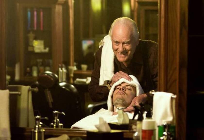 "Larry Hagman gives Josh Henderson a close shave in TNT's reboot of ""Dallas."""