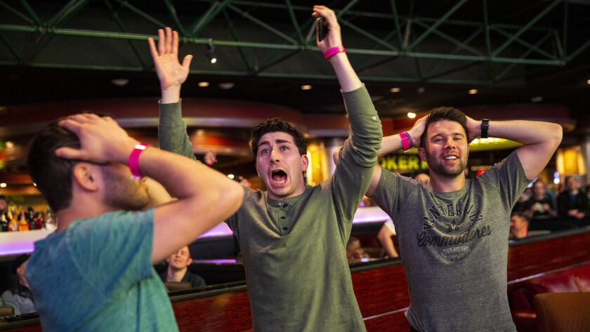 LAS VEGAS, NEV. - MARCH 21: Meat Stevens, from New York, NY, center, and his friends react to a NCAA