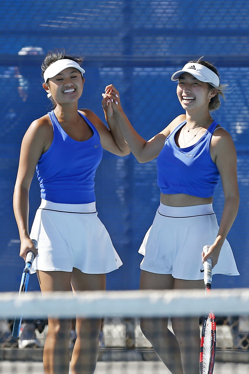 Fountain Valley No. 2 doubles partners Paige Ngo, left, and Christy Chau celebrate a point as they play against Villa Park.