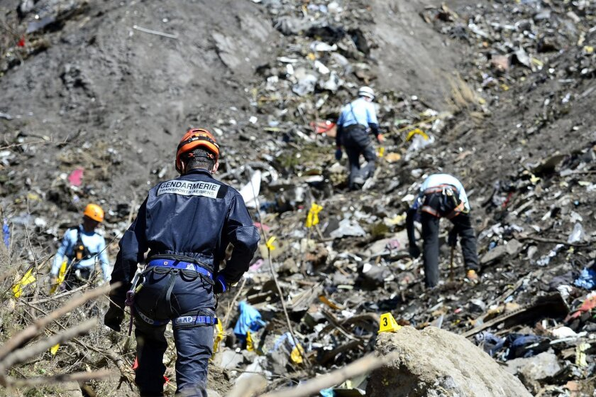 FILE - In this file photo dated Tuesday, March 24, 2015, provided by the French Interior Ministry, French emergency rescue services work at the site of the Germanwings jet that crashed on Tuesday, March 24, 2015 near Seyne-les-Alpes, France. The co-pilot of the Germanwings jet barricaded himself in
