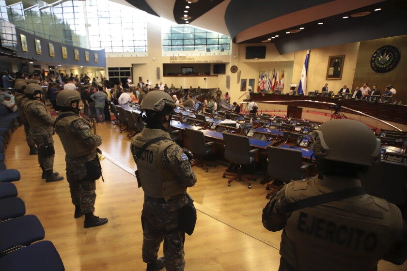 Armed soldiers enter El Salvador's congressional chamber on the orders of President Nayib Bukele