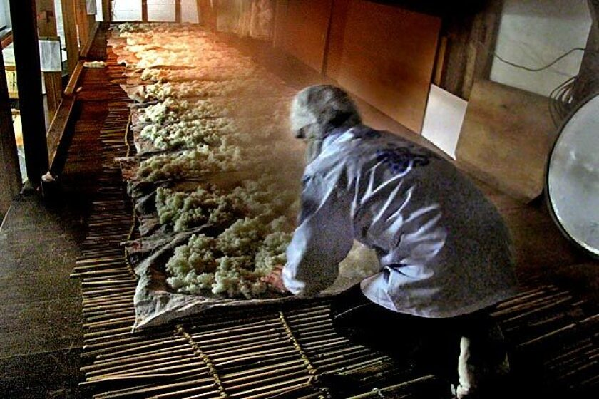 Rice cools on mats as part of the sake-making process.