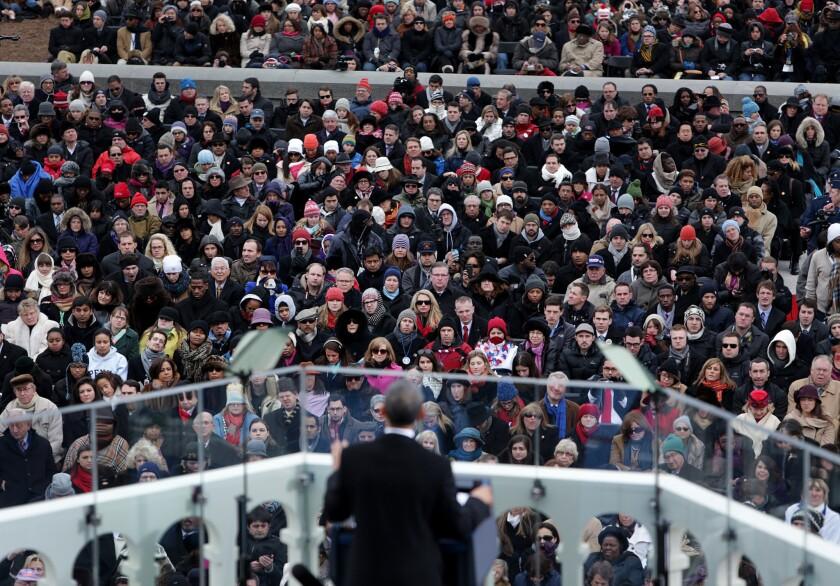 Attendees listen as President Obama speaks during the presidential inauguration.