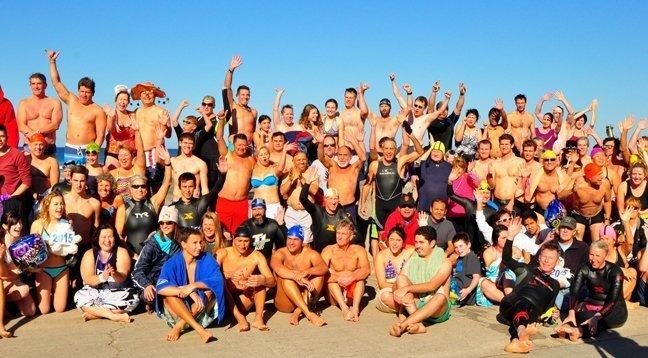 Some of the estimated 300 swimmers prior to the Polar Bear Plunge. (La Jolla Cove Swim Club's annual New Year's morning Polar Bear Plunge, La Jolla Shores Beach, Jan. 1, 2015)