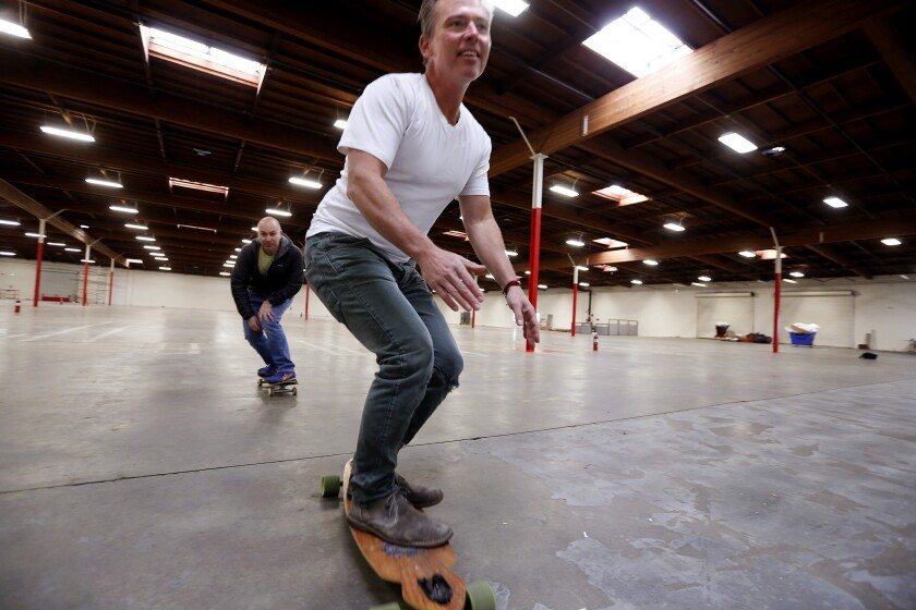 Patterson and Harris getting in some fun before manufacturing equipment arrives to ruin their skateboard rink.