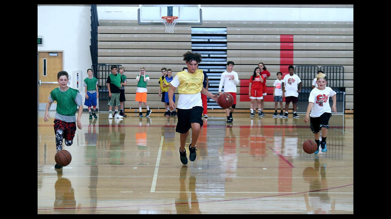 Photo Gallery: Tribe Youth Basketball Camp at Burroughs High