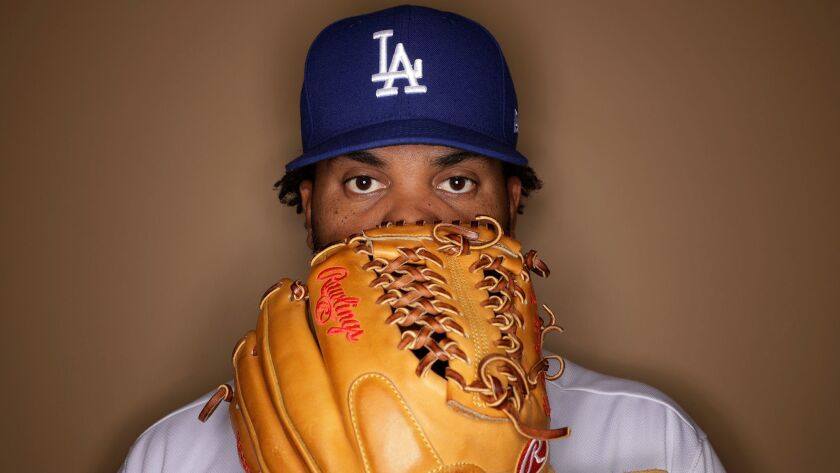 Los Angeles Dodgers' Kenley Jansen poses for a picture during the team's photo day Friday, Feb. 24,