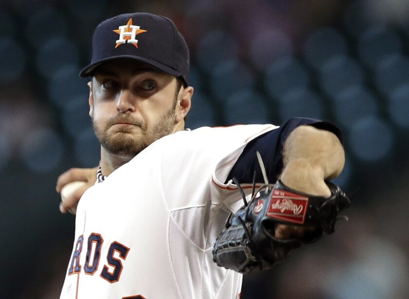 Houston Astros' Jarred Cosart delivers a pitch against the Los Angeles Angels in the first inning of a baseball game Wednesday, June 4, 2014, in Houston. (AP Photo/Pat Sullivan)