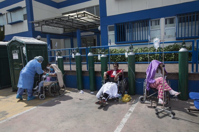 People infected with COVID-19 wait for a hospital bed