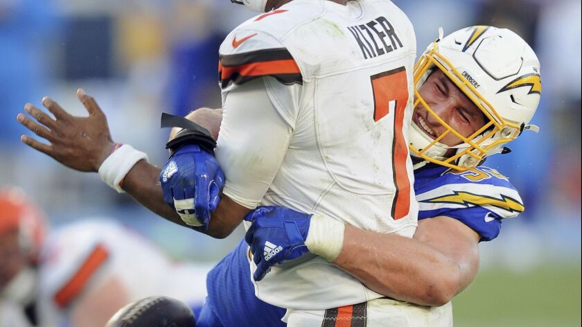 FILE - In this Dec. 3, 2017, file photo, Chargers defense end Joey Boss (99) causes a fumble as he h