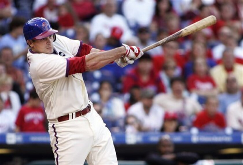 Philadelphia Phillies' Paul Hoover swings through for an RBI-single that scored John Mayberry Jr. to win a baseball game with the Florida Marlins in the tenth inning Sunday, Oct. 4, 2009, in Philadelphia. The Phillies won 7-6. (AP Photo/Tom Mihalek)