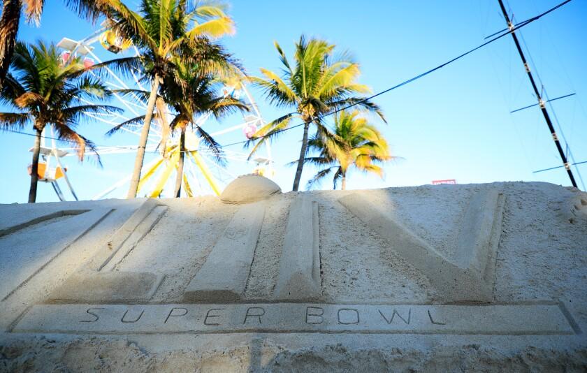 Super Bowl LIV logo in sand