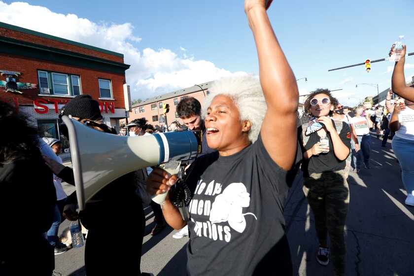 """Cariol Horne marches during a protest organized by We Pump 716 and the Liberation Collective, Friday, Sept. 4, 2020, in Buffalo. Horne, a Buffalo police officer who was fired for trying to stop another officer from using a chokehold on a handcuffed suspect, has won a years-long legal fight to collect her pension on Tuesday, April 13, 2021. A state Supreme Court judge cited the changing landscape around the use of force by police and a recently passed """"duty to intervene"""" statute adopted by the city. (Sharon Cantillon/The Buffalo News via AP)"""