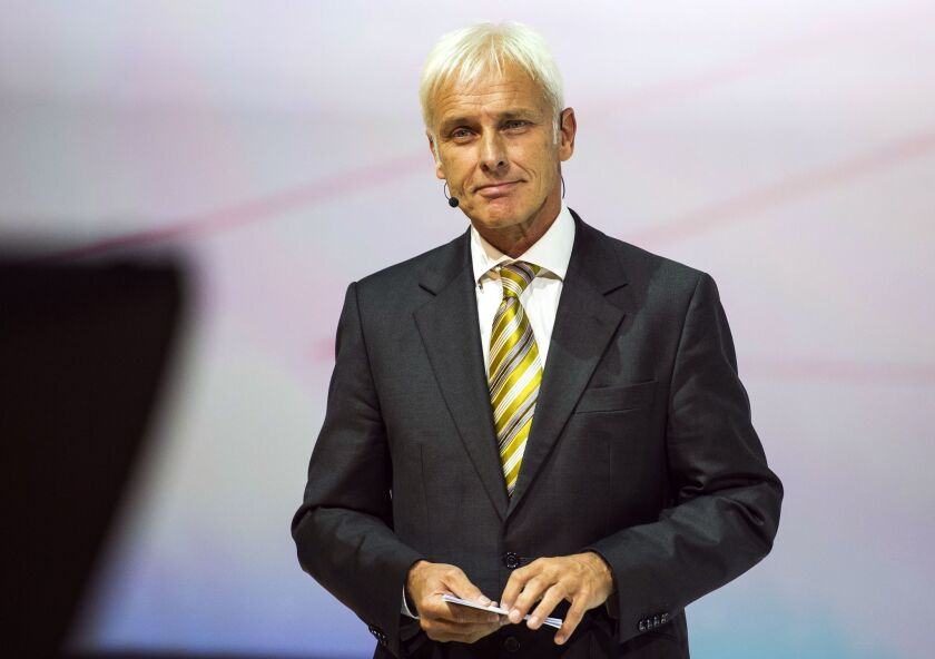 Volkswagen named Matthias Mueller, its Porsche head, as chief executive to replace Martin Winterkorn, who quit amid the German automaker's emissions scandal.