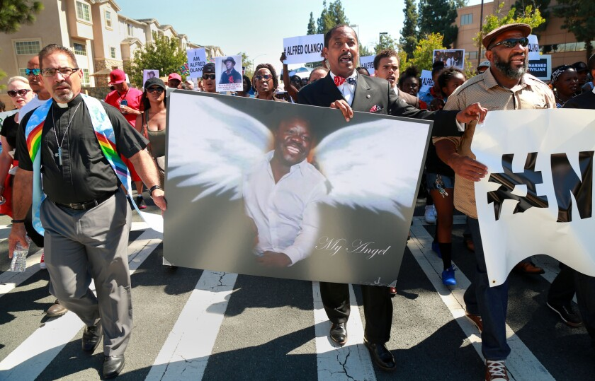Family members of Alfred Olango led a Unity rally around the El Cajon Civic Center in October 2016